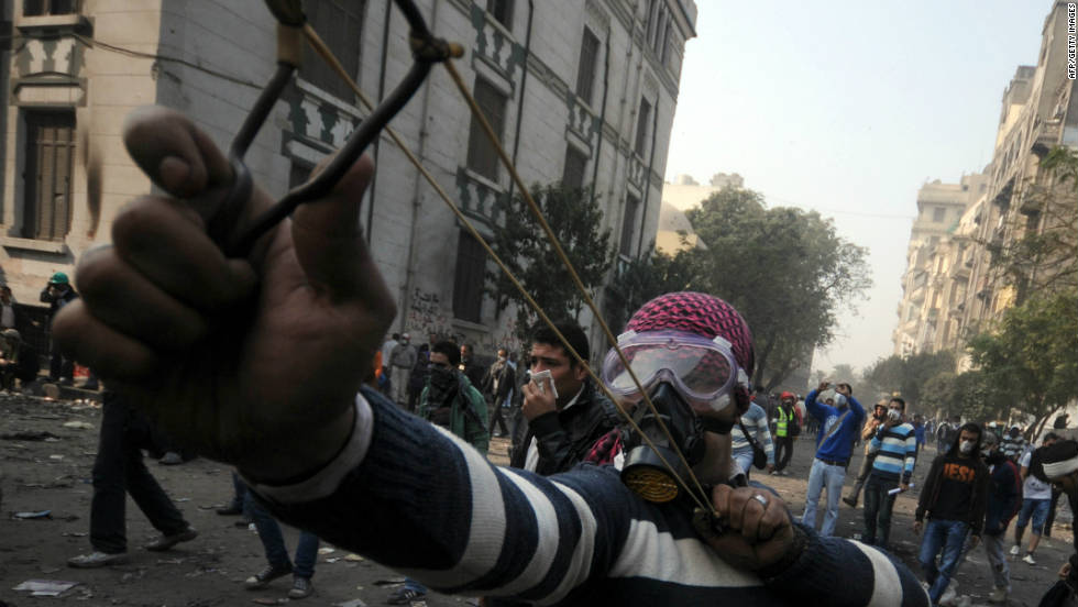 A young Egyptian fires a slingshot during clashes with police Tuesday in Tahrir Square.