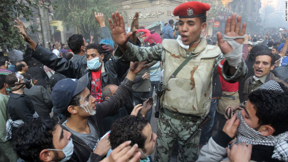 An Egyptian soldier attempts to control a crowd of protesters Tuesday in Tahrir Square.
