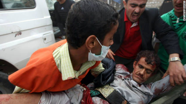 A wounded Yemeni protester is rushed to a makeshift hospital in Sanaa's Change Square on November 24, 2011.