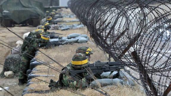 South Korean Marines mark the first anniversary of North Korea's artillery attacks on Yeonpyeong Island on November 23.
