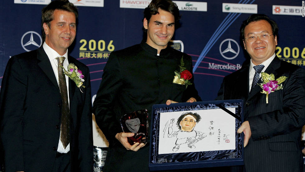 The Australian took the finals back to China in 2005. Here he is pictured with Federer and Minhang district director Chen Jing ahead of the 2006 Masters Cup in Shanghai.