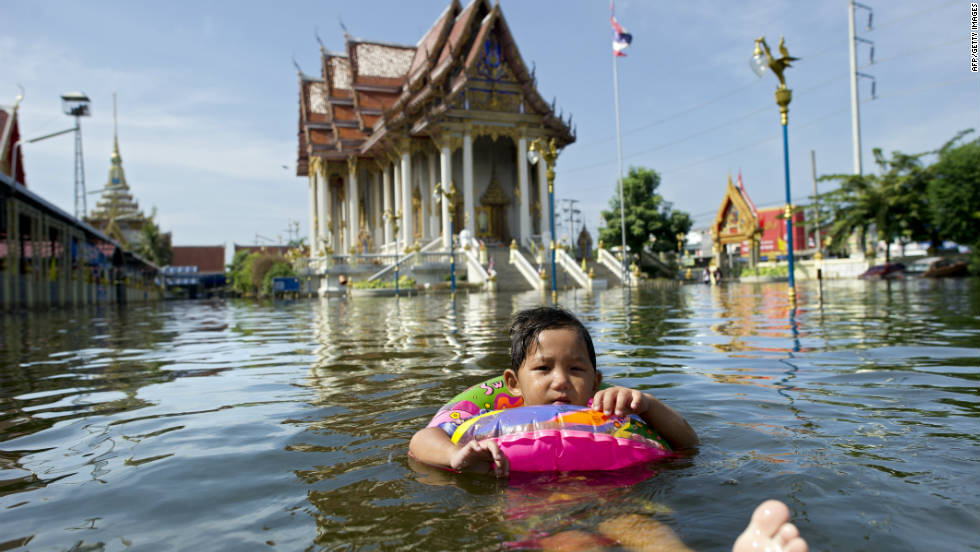 A young girl swims in flood waters near Bangkok airport. The Thai capital was subjected to the worst flooding in living memory during the 2011 monsoon season.