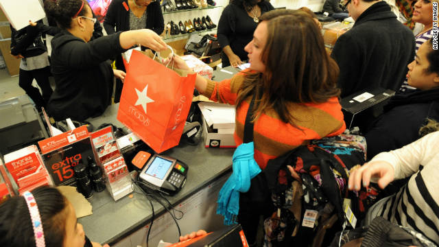 People make purchases inside Macy's in New York after the midnight opening to begin the 'Black Friday' shopping weekend.