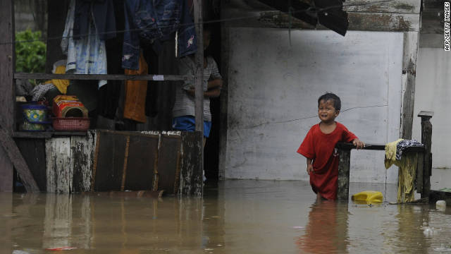 A boy cries as he stands in floodwaters outside his house in Thailand's southern province of Narathiwat on November 23.