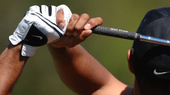 """""""The grip is one of the most important aspects of the swing. Most people grip the club too much in the palm of the hand, which creates tremendous tension and doesn"""