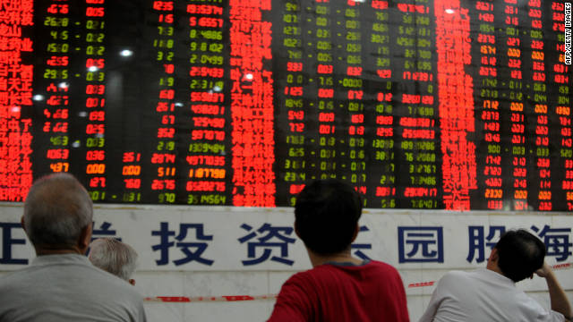 Chinese stock investors check their share prices at a security firm in Wuhan.