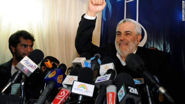 Abdelilah Benkirane, general secretary of the Justice and Development Party, raises his fist in victory during a news conference in Rabat, Morocco,  on Sunday.