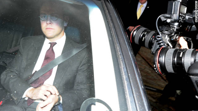BSkyB Chairman James Murdoch (L) leaves the company's annual general meeting in London, on November 29, 2011.