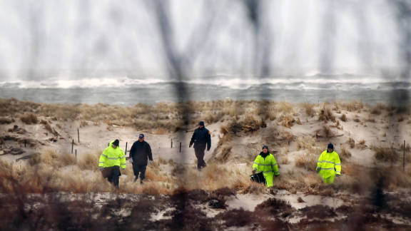 Suffolk County Police search an area of beach in April in Babylon, New York, near where police had found other human remains.