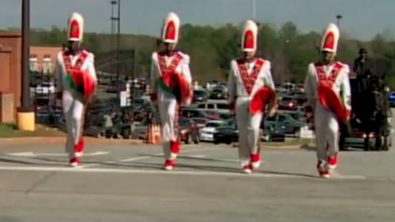 Marchers lead the funeral procession of FAMU drum major Robert Champion on November 30.