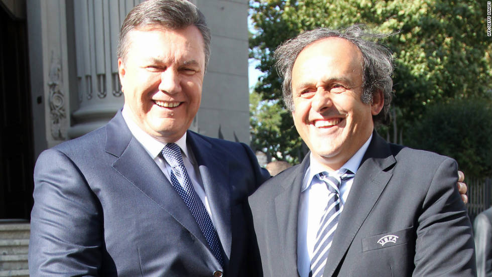 "Ukrainian President Viktor Yanukovych (L) shakes hands with Michel Platini on a recent visit to the country by UEFA's president. Platini said in 2008 that Ukraine needed to ""wake up"" and ""get going"" after a series of delays."