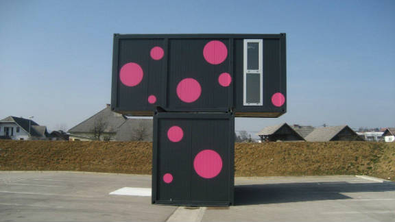 """Kotnik's own work with shipping containers explores the potential for living space. This contemporary weekend house with sticker facade """"expresses an individuality-based society"""" says the 31 year-old Slovenian architect."""