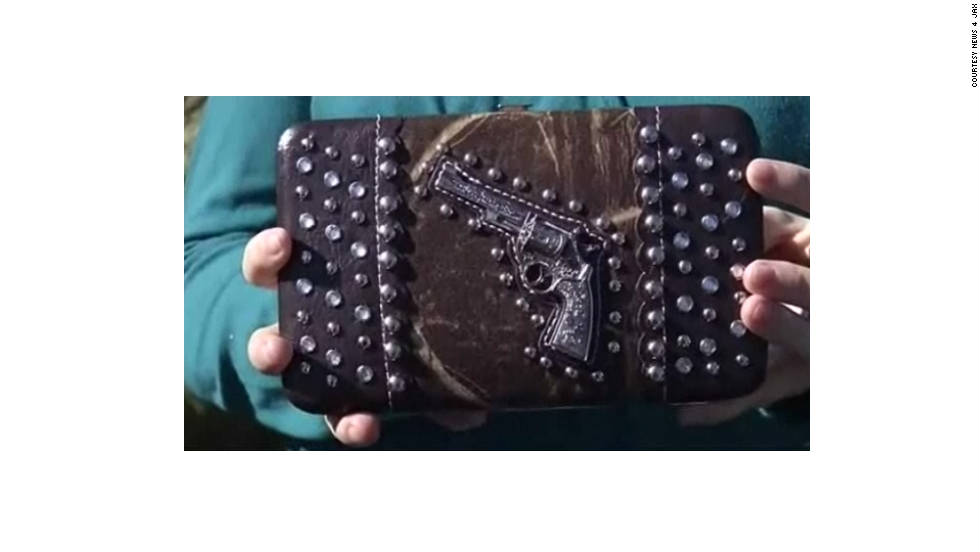 Products that mimic guns, like this purse with a gun design, aren't allowed as carry-on items, either. This replica was flagged by the Transportation Security Administration at the Norfolk, Virginia, airport in 2011.