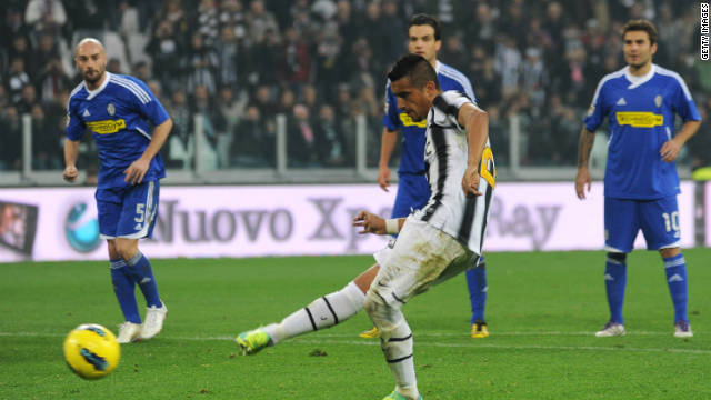 Arturo Vidal scores from the penalty spot as Juventus returned to the top of the Serie A table.