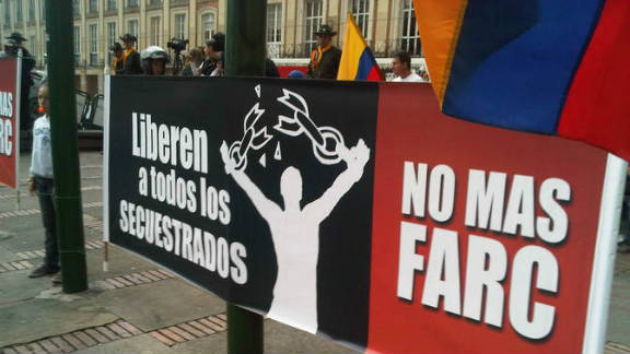Colombians march against FARC rebel group in 2011.