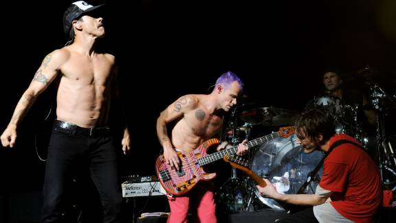 The Red Hot Chili Peppers, shown here performing at a benefit in August, were inducted into the Rock and Roll Hall of Fame.