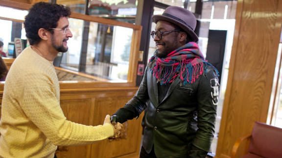 Musical artist will.i.am, right, shakes hands with Sal Dimiceli, one of this year's top 10 CNN Heroes.