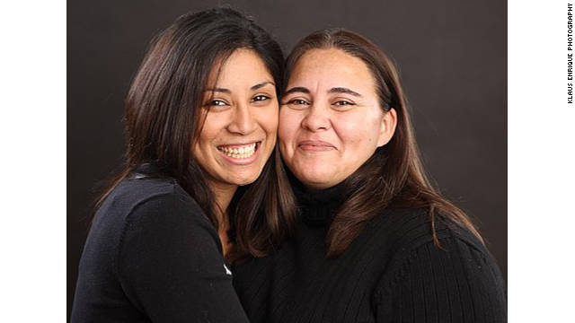 Monica Alcota (right) can remain in the U.S. with her wife Cristina Ojeda after Alcota's immigration case was dropped.