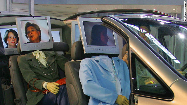 A photo illustration of mock passengers as computers. Cars now carry electronics and thousands of lines of code.