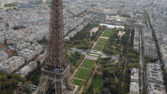 """Nicknamed """"la dame de fer"""", or """"iron lady,"""" the Eiffel Tower is located on the Champ de Mars in Paris, and was named after its designer and engineer Gustave Eiffel."""