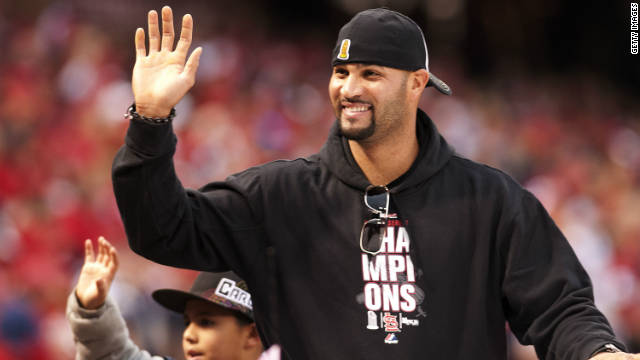 Albert Pujols of the St. Louis Cardinals joins in the World Series victory parade in October.
