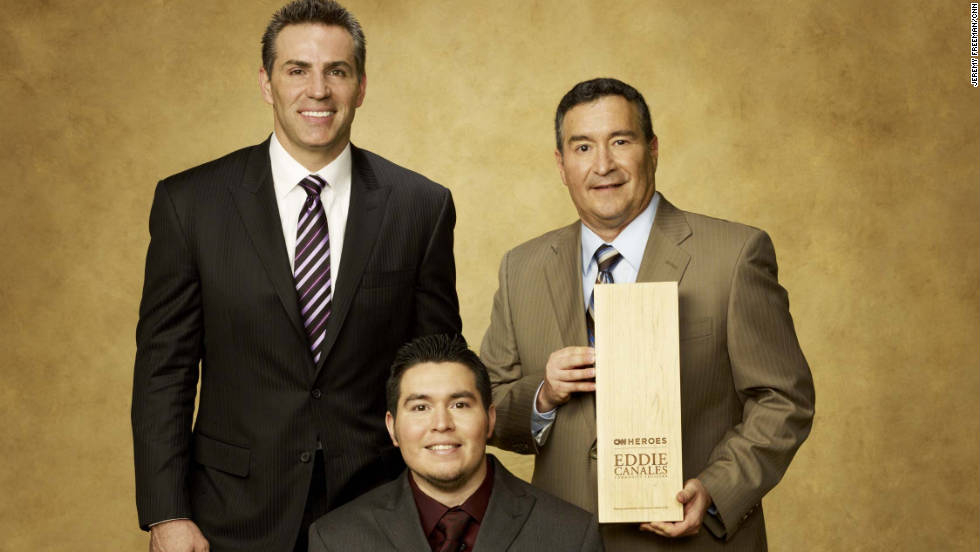 "Former NFL quarterback Kurt Warner joins CNN Hero Eddie Canales, founder of ""Gridiron Heroes,"" and his son."