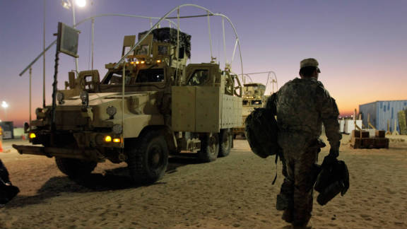 A U.S. Army soldier arriving in Kuwait after a final departure from Iraq last week.