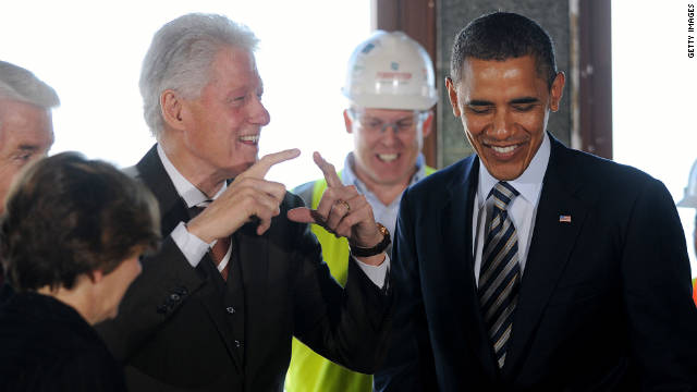 President Obama and former President Clinton share a laugh as they tour an energy-efficient building on December 2.