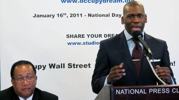 Activist Benjamin Chavis listens as Pastor Jamal Harrison Bryant tells why black pastors are joining the Occupy movement.