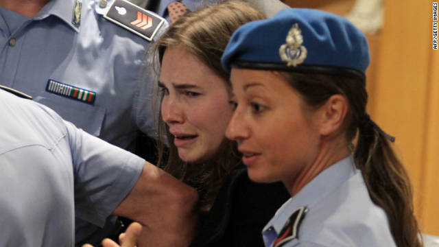 Knox breaks into tears as she leaves the court after being acquitted on October 3, 2011, for Kercher's murder.