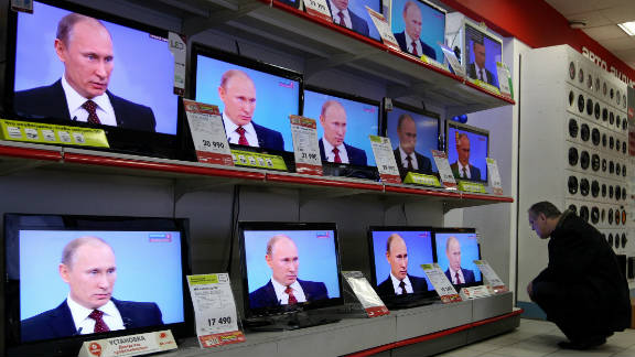 TV screens show Prime Minister Vladimir Putin