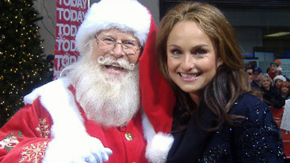 Tim Connaghan, seen here with chef and TV personality Giada De Laurentiis, is in the business of selling Santa. Not only is he out there, he