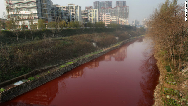 The Jian River flows red after being polluted with dye from an illegal workshop.