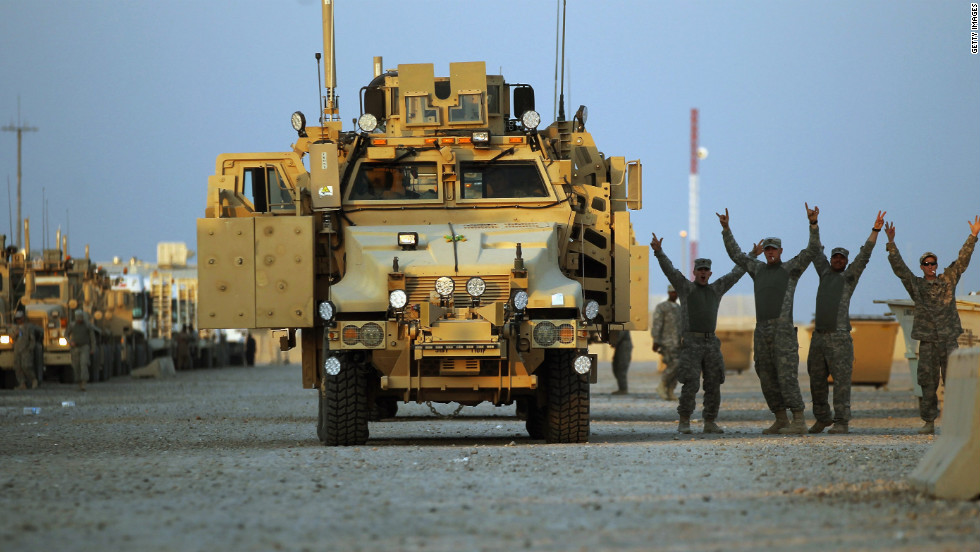 Soldiers rejoice in the convoy staging area before departing Camp Adder.