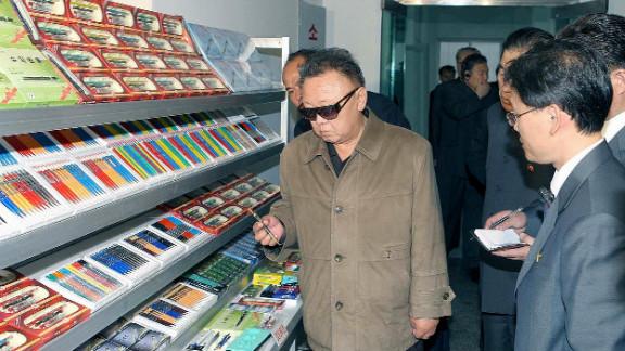 North Korean leader Kim Jong Il visiting a pencil factory in May 2011.