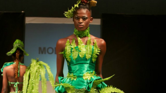 """This year's Nigeria Fashion Week showcased a """"Going Green"""" collection to create awareness of environmental issues. Dress by Modela Couture."""