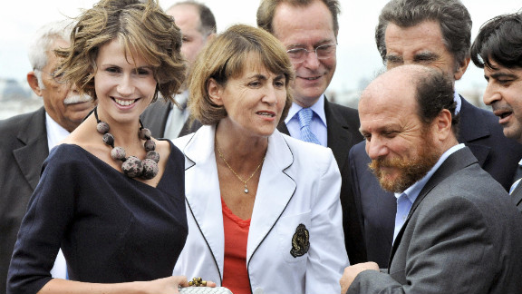 Asma al-Assad, left, chats with French Culture Minister Christine Albanel and Syrian artist Mustafa Ali in July 2008 in Paris.