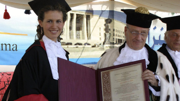 Asma al-Assad gets an honorary doctorate from Roberto Antonelli, the president of Rome's La Sapienza University, October 20, 2004, in the Syrian city of Ebla.