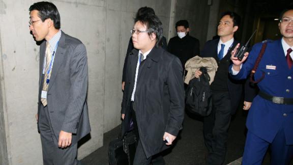 Investigators enter the headquarter of Olympus in Tokyo on December 21, 2011.