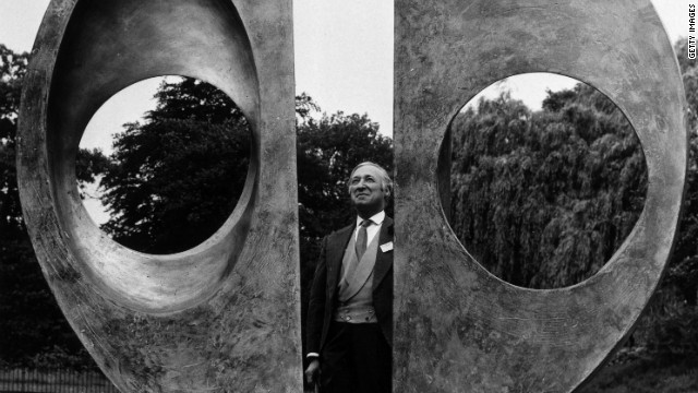 "Arts official Harold Sebag-Montefiore inspects Barbara Hepworth's ""Two Forms (Divided Circle)"" on its installation in Dulwich Park in 1970."