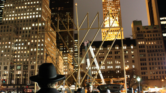 New Yorkers light a massive menorah in Manhattan on Tuesday to mark the beginning of Hanukkah.