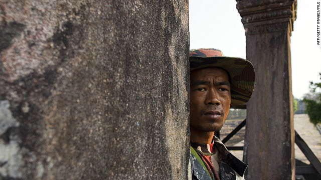 A Cambodian solider looks across at the Thai border from the ancient Preah Vihear temple in this file picture.