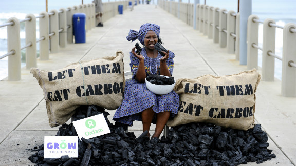 An Oxfam activist  in a protest aimed at the COP17 conference on climate change on December 9, in Durban, South Africa.