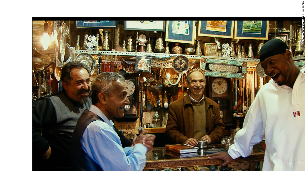 Sheppard tries his hand at bartering at a bazaar in the Iranian capital of Tehran.