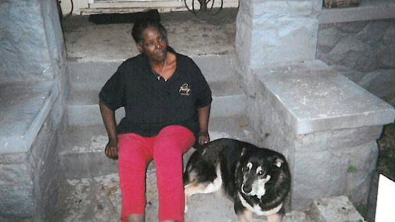 Nadine Turner rests beside her dog, Giorgio, in Atlanta.