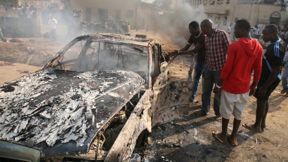 The devastating scene outside St Theresa Catholic Church near the Nigerian capital Abuja on Sunday.