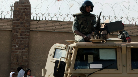 An Egyptian soldier stands guard outside courts at the Police Academy set up for the Mubarak trial in this file picture.