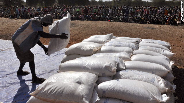 A worker lays out bags of grain at the Doro refugee camp about 26 miles from the border in South Sudan's Upper Nile state.
