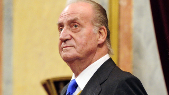 Spain's King Juan Carlos and Queen Sofia arrive to open Parliament in Madrid on Tuesday.