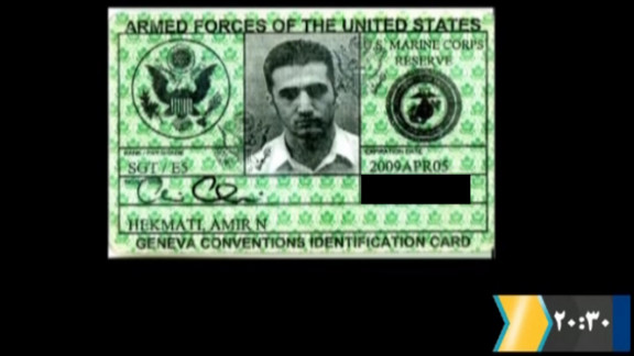 A video grab from official Iranian state TV on December 18 shows a card identifying the bearer as Amir Hekmati.
